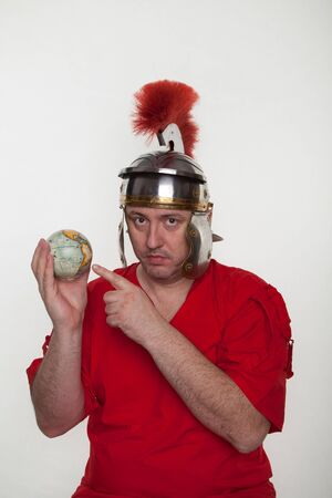 A roman soldier with a globe on the white background.