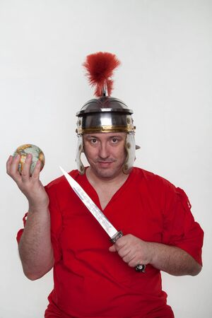 A roman soldier with a globe and dagger on the white background.