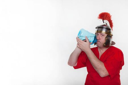A roman soldier drink from the water bottle on the white background.