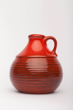 Old red vase  on the white background, isolated Stock fotó