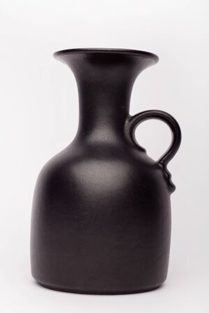 Old black vase  on the white background, isolated