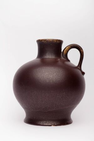 Old brown vase  on the white background, isolated Stock fotó