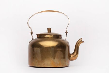 Old brass teapot on the white background, isolated