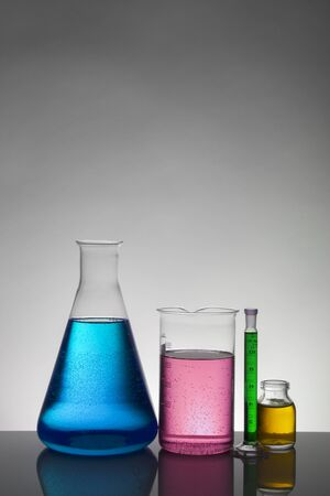Liquid in laboratory bottles. Scientific biochemical laboratory. Colorful liquid. Isolated on white background,  a group of bottles. Test tubes. Foto de archivo