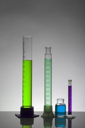 Liquid in laboratory bottles. Scientific biochemical laboratory. Colorful liquid. Isolated on white background,  a group of bottles. Test tubes. 版權商用圖片
