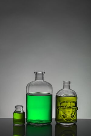 Liquid in laboratory bottles. Scientific biochemical laboratory. Colorful liquid. Isolated on white background,  a group of bottles. Test tubes. 스톡 콘텐츠