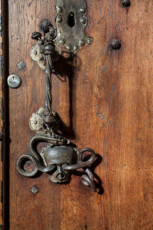 ornately decorated medieval wooden door, photographed in a german church, schwaebisch hall Stok Fotoğraf