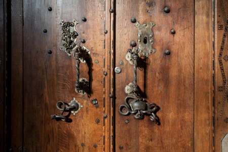 ornately decorated medieval wooden door, photographed in a german church, schwaebisch hall 스톡 콘텐츠