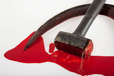 Hammer and sickle smeared with blood, on a white background. Visual description of a totalitarian state. Standard-Bild