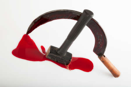 Hammer and sickle smeared with blood, on a white background. Visual description of a totalitarian state. Stok Fotoğraf
