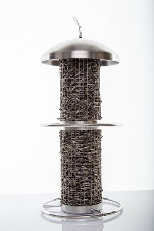 Stainless steel bird feeders, Isolated photo.