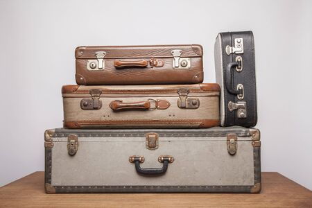 Old, retro, suitcases lie on the table with white background. Obsolete suitcase. Stok Fotoğraf