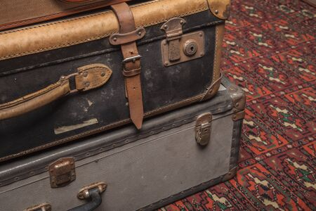 Old, retro, suitcases lie on the table with white background. Obsolete suitcase lying on the carpet Stok Fotoğraf
