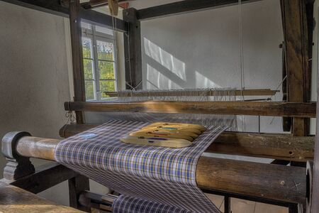 Schwaebisch Hall, Wackershofen, Germany - 15 October 2019: Interior views of a german village house. View from an old german loom Editöryel
