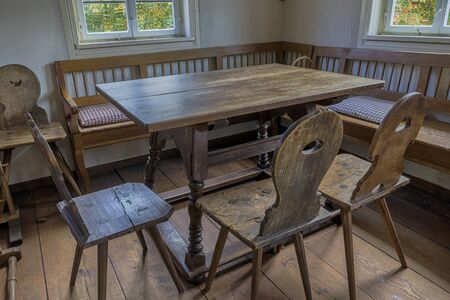 Schwaebisch Hall, Wackershofen, Germany - 15 October 2019: Interior views of a german village house. View from an old rustic wooden dining table