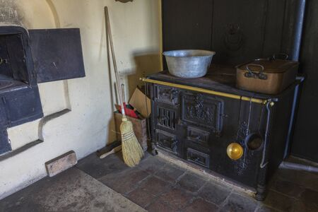 Schwaebisch Hall, Wackershofen, Germany - 15 October 2019: Interior views of a german village house. View of an old, antique kitchen stove