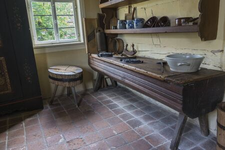 Schwaebisch Hall, Wackershofen, Germany - 15 October 2019: Interior views of a german village house. View of an old, antique kitchen table with pots Editöryel