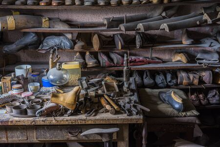 Schwaebisch Hall, Wackershofen, Germany - 15 October 2019: View into a shoemakers workshop with many old shoes and tools Editöryel