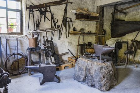 Schwaebisch Hall, Wackershofen, Germany - 15 October 2019: View in a blacksmits, smith workshop with many old tools Editöryel