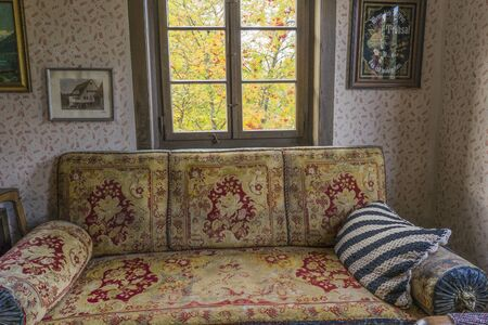 Schwaebisch Hall, Wackershofen, Germany - 15 October 2019: Interior views of a german village house. View into an antique sofa and window