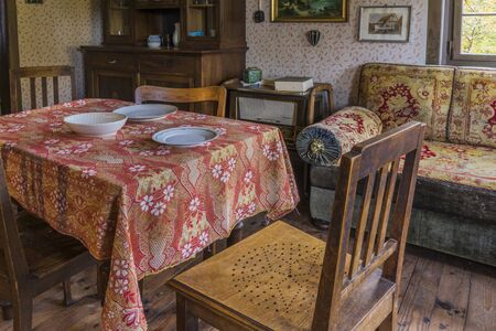 Schwaebisch Hall, Wackershofen, Germany - 15 October 2019: Interior views of a german village house. View from an old rustic wooden dining table and a sofa