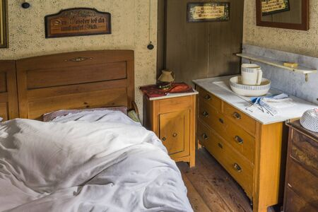 Schwaebisch Hall, Wackershofen, Germany - 15 October 2019: Interior views of a german village house. View in a german peasant bedroom with wash bowl