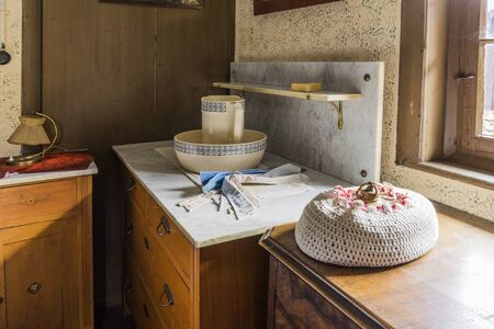 Schwaebisch Hall, Wackershofen, Germany - 15 October 2019: Interior views of a german village house. View in a german peasant bedroom with wash bowl and dresser Editöryel