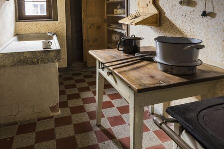 Schwaebisch Hall, Wackershofen, Germany - 15 October 2019: Interior views of a german village house. View from an old rustic wooden dining table and a sink Editöryel