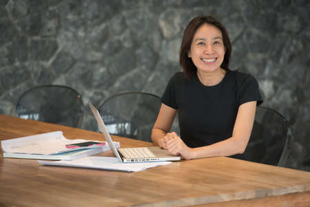 asian architect: woman architect working in home office