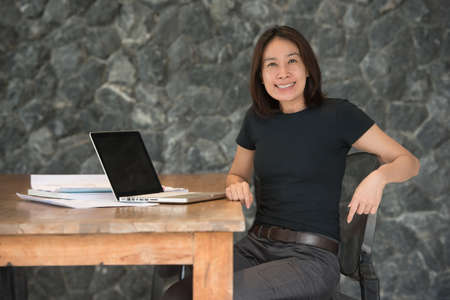 turning table: woman architect working in home office