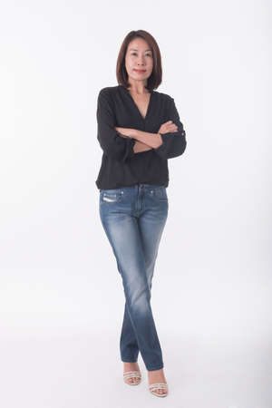 red jeans: asian middle age woman Stock Photo