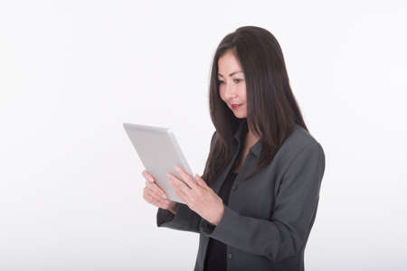 use computer: asian business woman use computer tablet