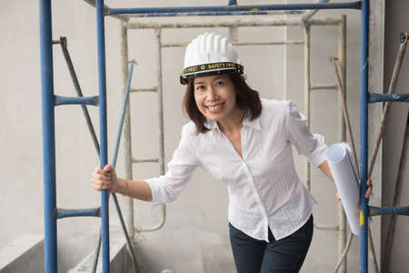 working woman: woman architect working at construction site Stock Photo