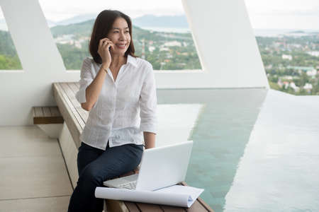 working woman: woman architect working in home office