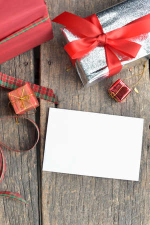 white card: blank white card and gifts set on old vintage floor
