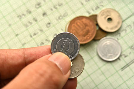 japanese currency: hand hold japanese currency coins
