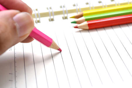 diagonal diary education: color pencils on white paper
