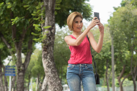 out door: Asian woman using smart phone out door