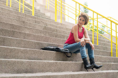 out door: portrait of asian woman sitting on out door stair