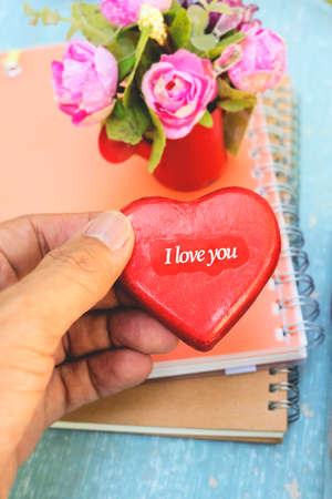 heart shaped stuff: hand hold heat shape paper with word I love you