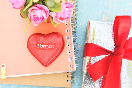 heart shaped stuff: heart shape paper with word I love you on note book