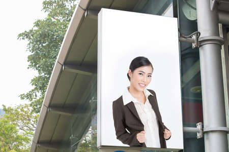 display advertising: billboard with picture of business woman