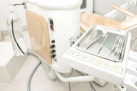 scaler: dental clinic equipment on the metal plate