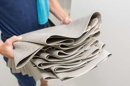 handy man: handy man preparing wallpaper Stock Photo