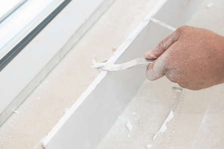 artisanry: hand cutting plasterboards Stock Photo