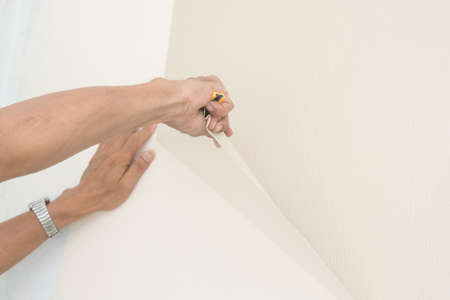 trashy: Removal of wallpaper. Stock Photo