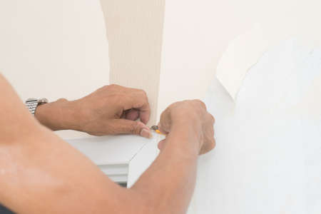 gash: Removal of wallpaper. Stock Photo
