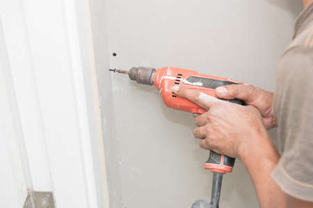 hand drill: Construction worker holding the hand drill