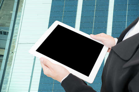 hand hold computer tablet on solar cell background