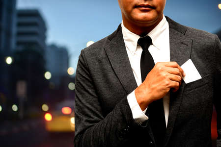 business man with name card composite with city light background Stock Photo